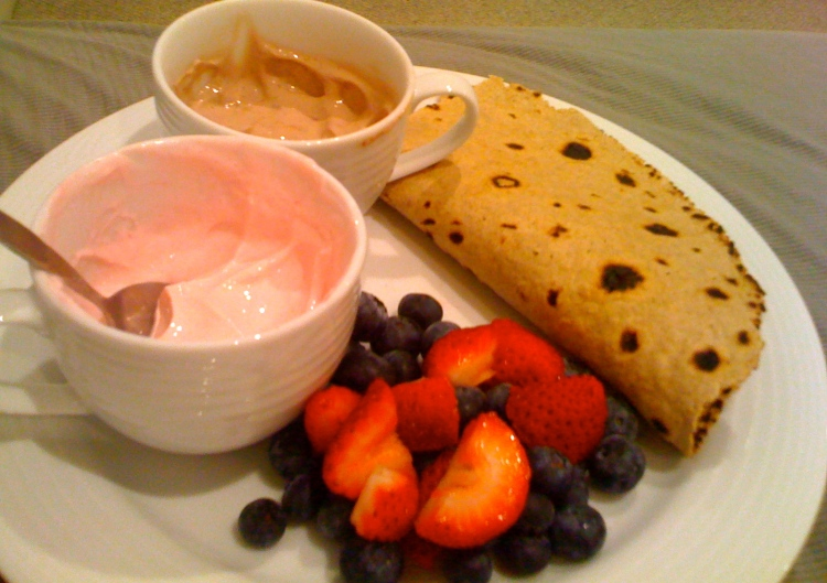 Another example of a high fibre wrap with some greek yoghurt for protein and fresh berries.