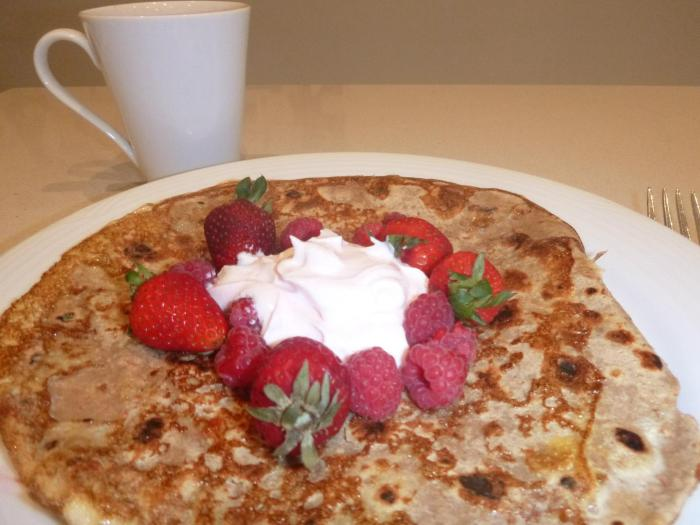 "A BARLEYmax ""pancake"" topped with strawberries and greek yoghurt - 100% there is cinnamon in the egg mixture I coated the wrap in before I heated it on the stove!"
