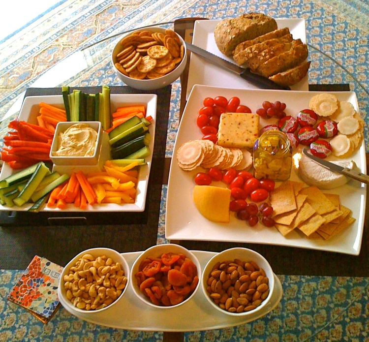 I threw in some nuts and whole grain sour dough bread to the cheese and vegetable platters.
