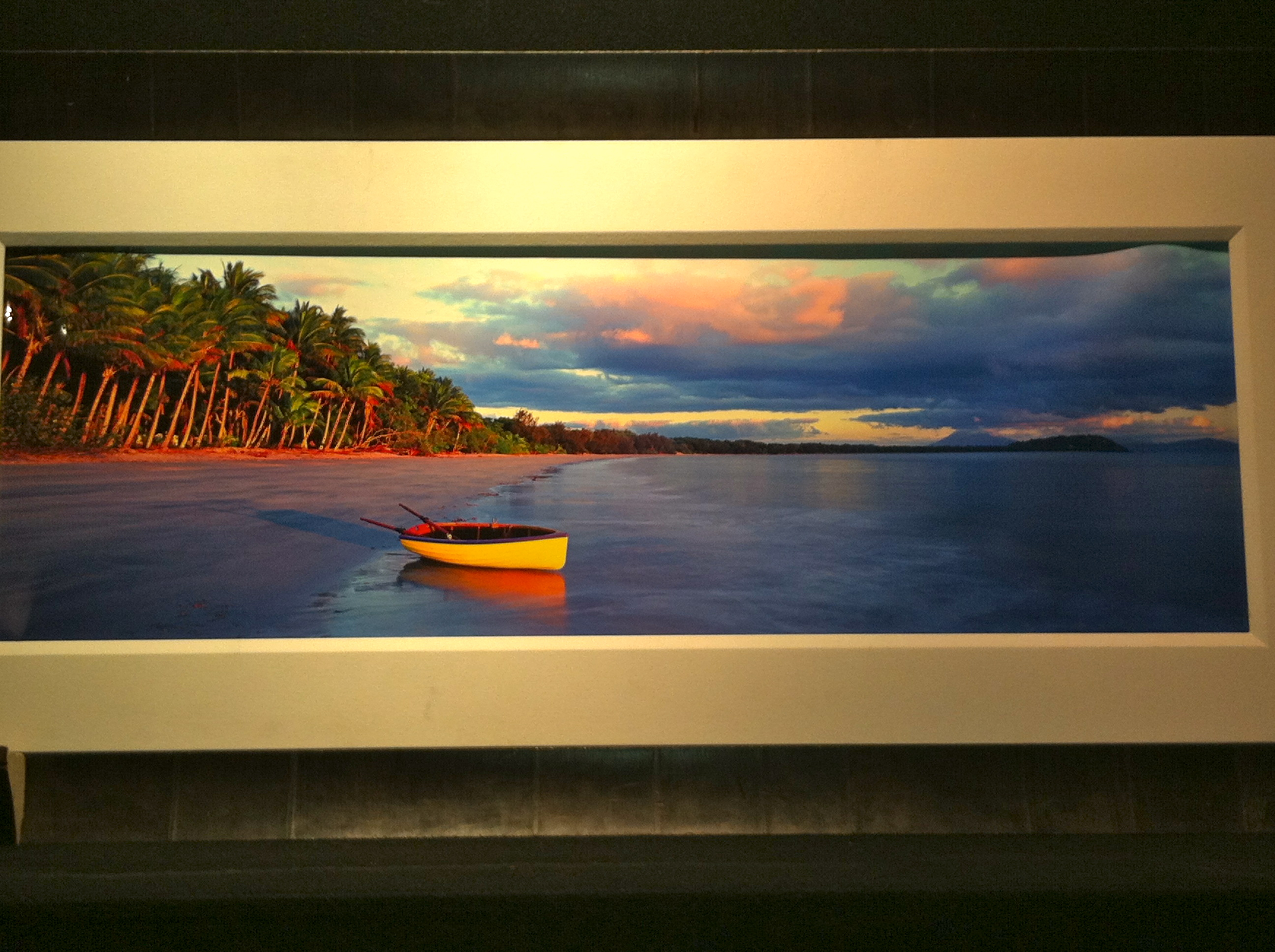 """Peter Lik, my favourite photographer, has a gallery in Soho. I cracked an invite to a party they were hosting and had them put up """"beached"""", the image I have above my bed in Australia, just to """"take me home"""" for 20 minutes…amazingly calming!"""