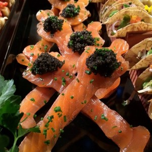 smoked salmon and caviar wrapped around a spoon in an oscar shape. Love it.