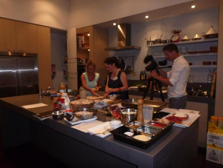 Kara Landau leading a cooking demonstration along side a chef on behalf of her client SunRice with a group of eminent mummy bloggers to promote their new product range.
